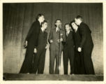 Photograph of six St. John's College students singing in a variety show