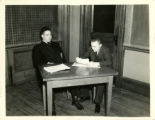 Photograph of a St. John's college professor and a student at a desk